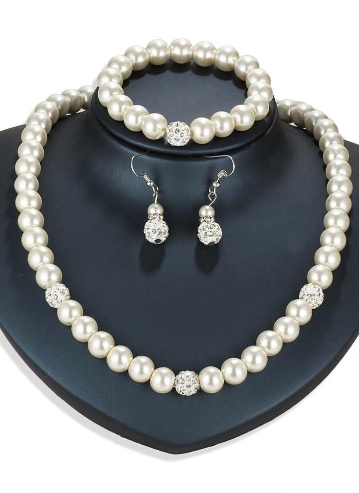 779f1e385edd Personalidad de la moda Conjunto de joyas de perlas Collar Pendientes  Pulsera para mujeres compromiso de