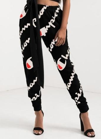 Les pantalons de sport occasionnels de femmes ont imprimé le pantalon lâche de harem de poche de poche