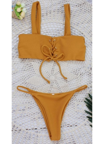 Bikini stringivita da donna a vita bassa. Taglio corto a tinta unita
