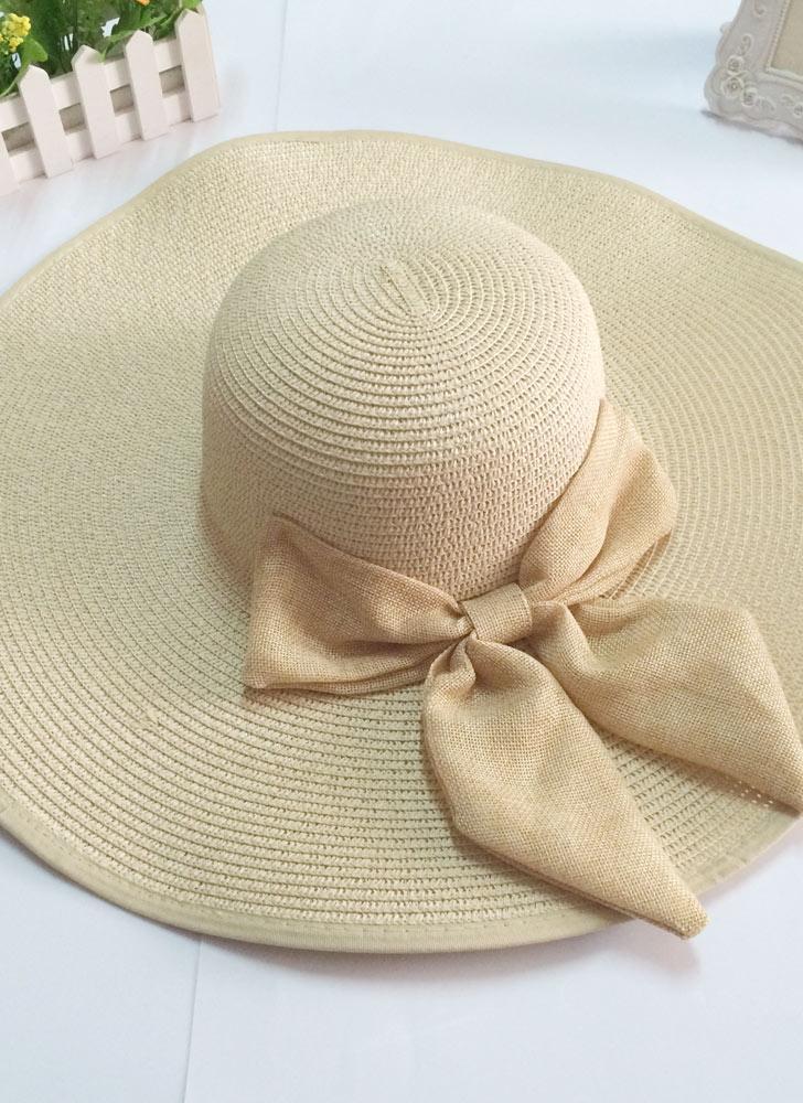 Nuova moda donna tesa larga di paglia cappello floscio di prua pieghevole  sole spiaggia Cap 885f58a62f3c