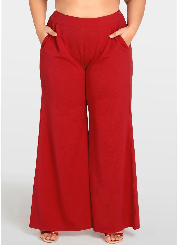 Pantaloni larghi delle donne dei pantaloni delle gambe larghi delle tasche di dimensione più delle donne