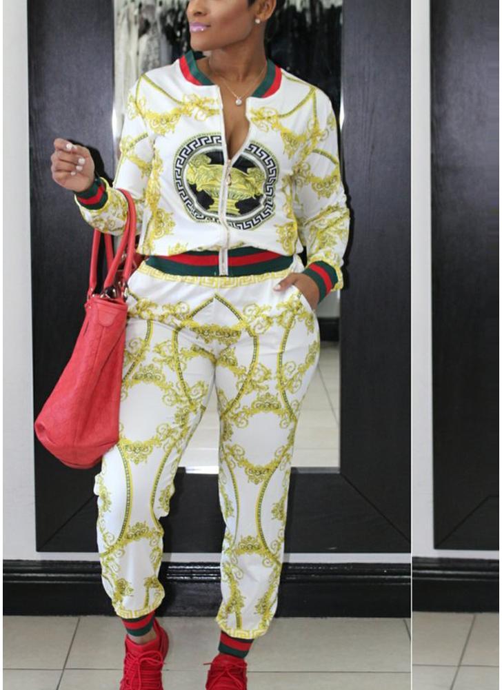 Las mujeres de la moda se divierten la impresión a rayas de dos piezas Set bolsillos con cremallera de cuello alto de manga larga trajes