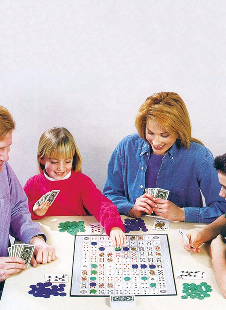 Party Games Sequence Playing Cards Game An Exciting Game of Strategy Friends Playing Together