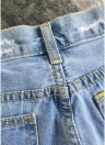Vaqueros rasgados lavados de cintura alta