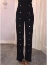 Pantalon large sans manches à col en V et rivets