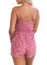 El nudo atractivo del verano ahueca hacia fuera los mamelucos de las mujeres traseras de la impresión floral