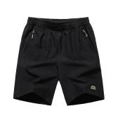 Hombre Running Fitness Sports Pantalones de secado rápido Pantalones cortos transpirables de color puro con bolsillos