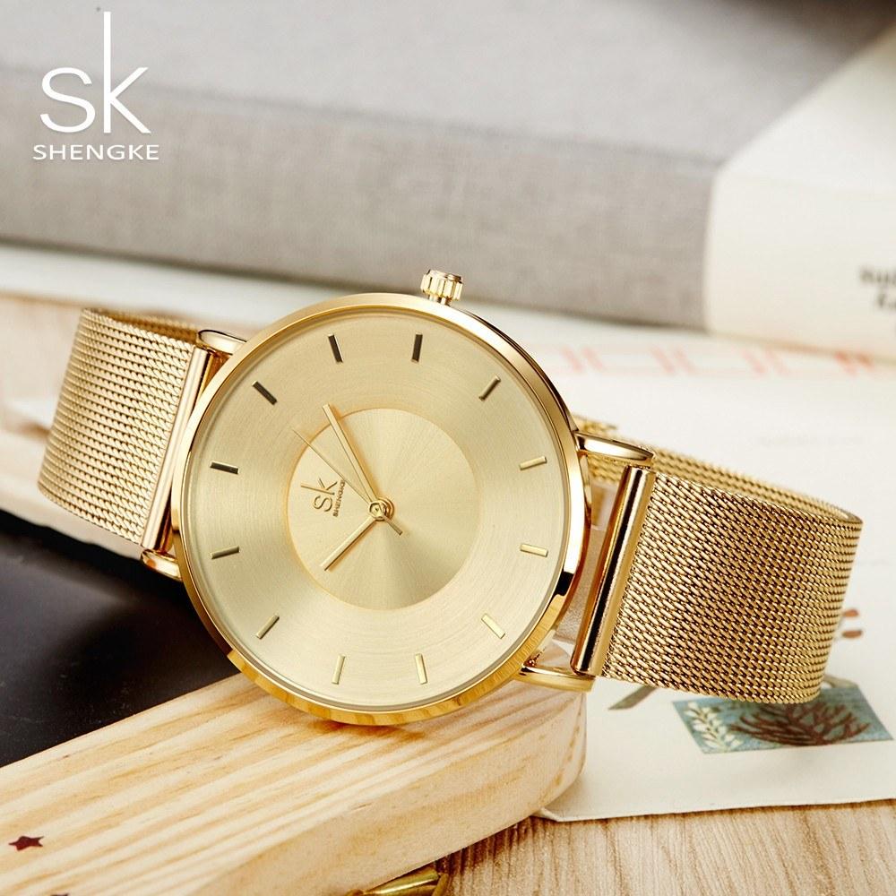 73736b881 SK سيدة ساعة اليد ذات جودة عالية رقيقة جدا الكوارتز ماء بسيطة حزام الفولاذ  المقاوم للصدأ