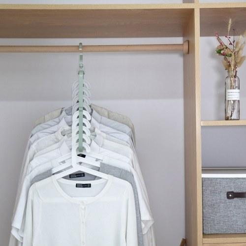 Девять отверстий Вращающаяся вешалка Магия Многофункциональная складная вешалка для одежды Сушилка Вешалка Шкаф компактный фото