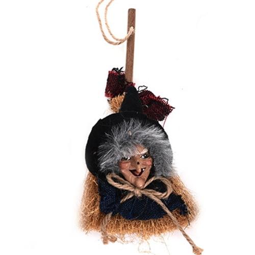 Bruxa de Halloween com decoração de bruxa