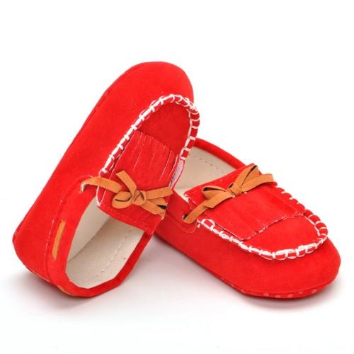 Il nuovo bambino unisex dell'arco della nappa non lega le scarpe comode di bambino morbide molle per la primavera ed l'autunno