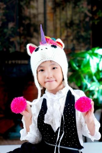 Los niños de dibujos animados hermoso sombrero caliente punto casquillo del invierno unicornio para niños