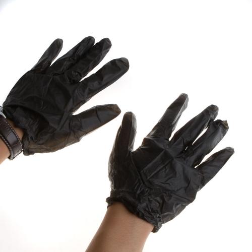 使い捨てのタトゥーのラテックス手袋